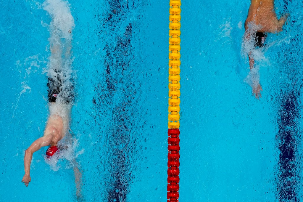 Tom Dean, of Britain and Kieran Smith, of the United States swim in the final of the men's 200-meter freestyle at the 2020 Olympics on July 27, 2021, in Tokyo, Japan.