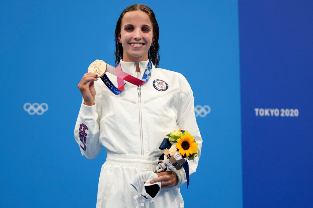 Regan Smith of the United States holds up her bronze medal for the women's 100-meter backstroke at the 2020 Olympics on July 27, 2021, in Tokyo, Japan.