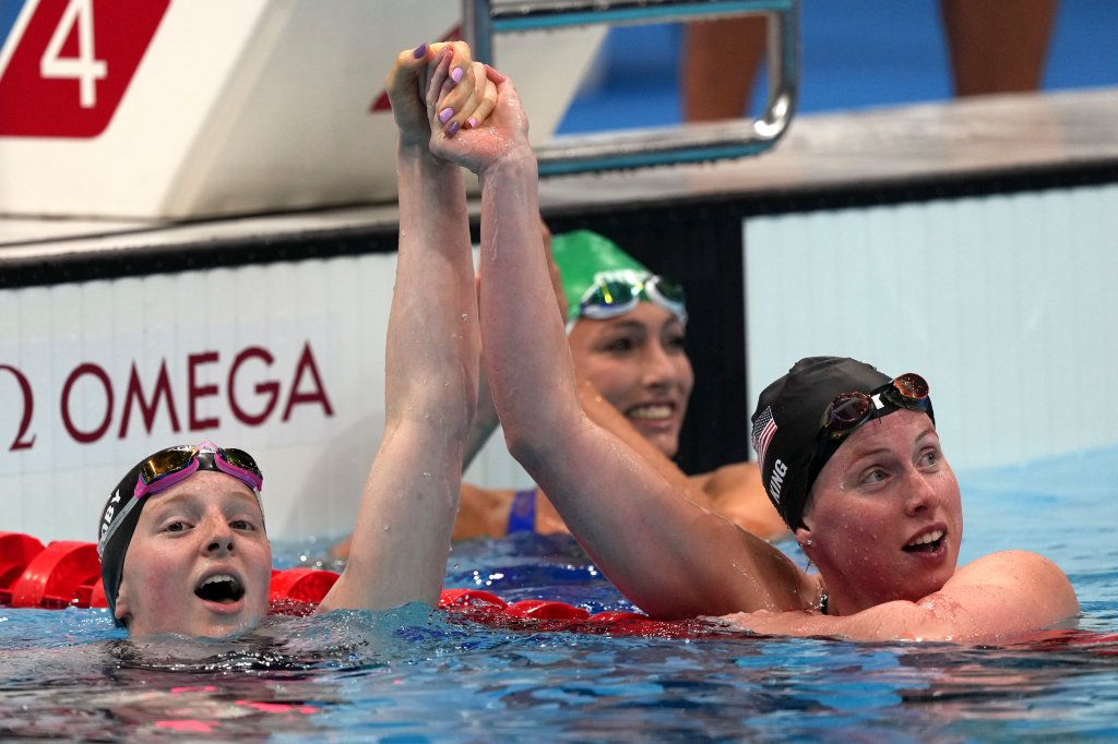 Gold medalist Lydia Jacoby, left, of the United States, is congratulated by bronze medalist and compatriot Lilly King after winning the final of the women's 100-meter breaststroke at the 2020 Summer Olympics, Tuesday, July 27, 2021, in Tokyo, Japan.