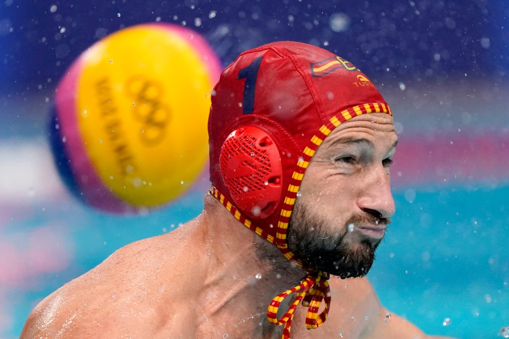 Spain's goalkeeper Daniel Lopez Pinedo tries to block a shot that sails past for a goal during a preliminary round men's water polo match against Montenegro at the 2020 Olympics on July 27, 2021, in Tokyo, Japan.