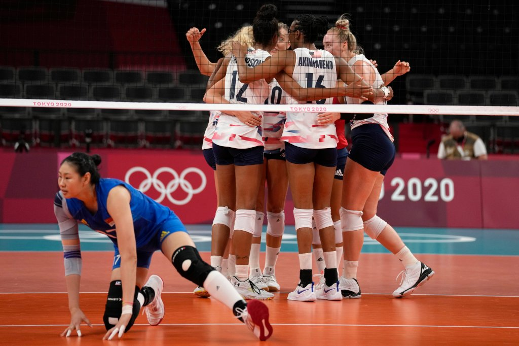 United States teammates celebrate during the women's volleyball preliminary round pool B match between China and United States at the 2020 Olympics on July 27, 2021, in Tokyo, Japan.