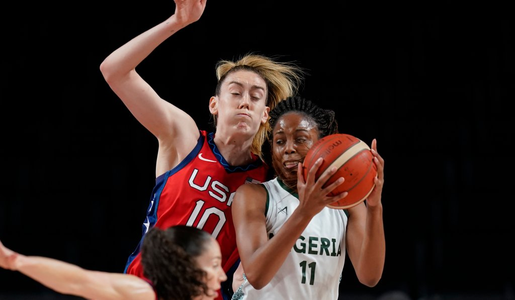 Nigeria's Adaora Elonu (11) drives past United States' Breanna Stewart (10) during women's basketball preliminary round game at the 2020 Olympics on July 27, 2021, in Saitama, Japan.