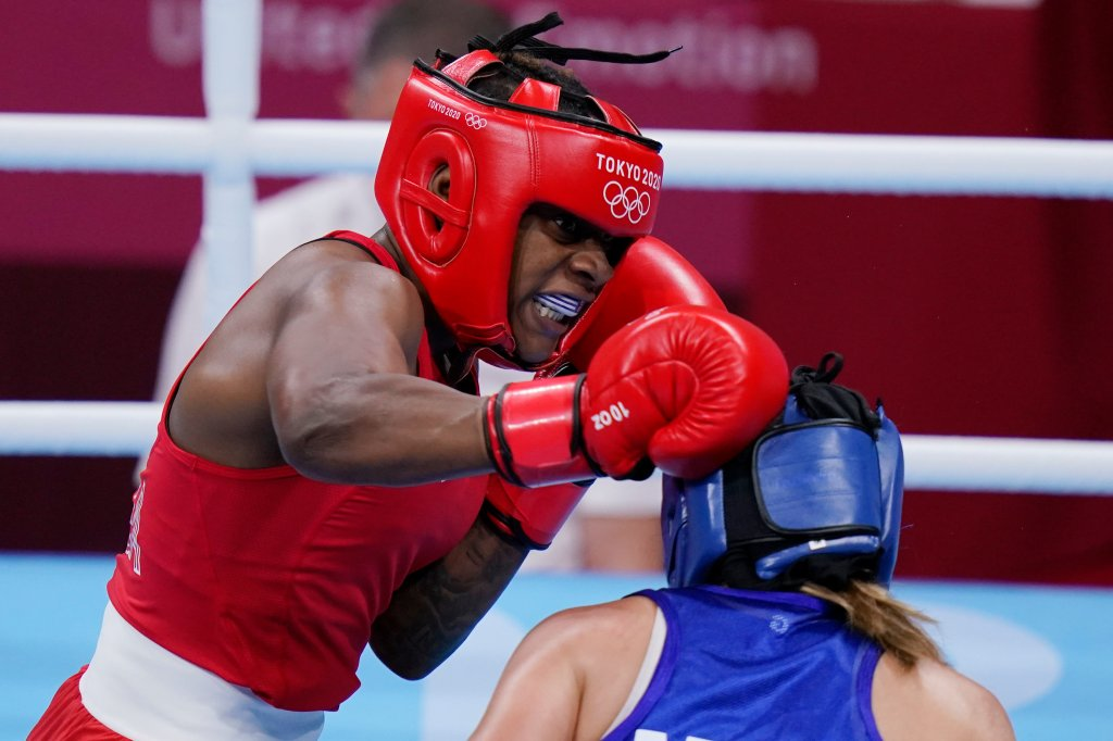 Oshae Jones of US, left, exchanges punches with Mexico's Brianda Tamara Cruz Sandoval during the women's welterweight 69-kg boxing match at the 2020 Summer Olympics, Tuesday, July 27, 2021, in Tokyo, Japan.