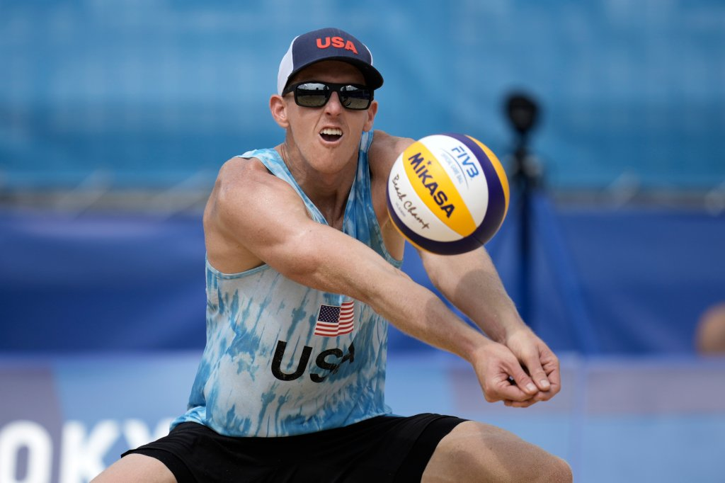 Tri Bourne, of the United States, returns a shot during a men's beach volleyball match against Switzerland at the 2020 Olympics, Wednesday, July 28, 2021, in Tokyo, Japan.