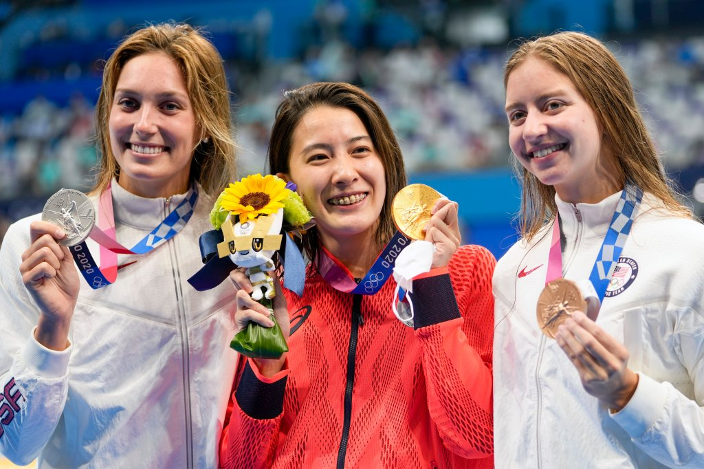 Gold medalist Yui Ohashi, centre, of Japan, stands with silver medalist Alex Walsh of the United States and bronze medalist Kate Douglass, right, of the United States, right, after the women's 200-meter individual medley final at the 2020 Summer Olympics, Wednesday, July 28, 2021, in Tokyo, Japan.