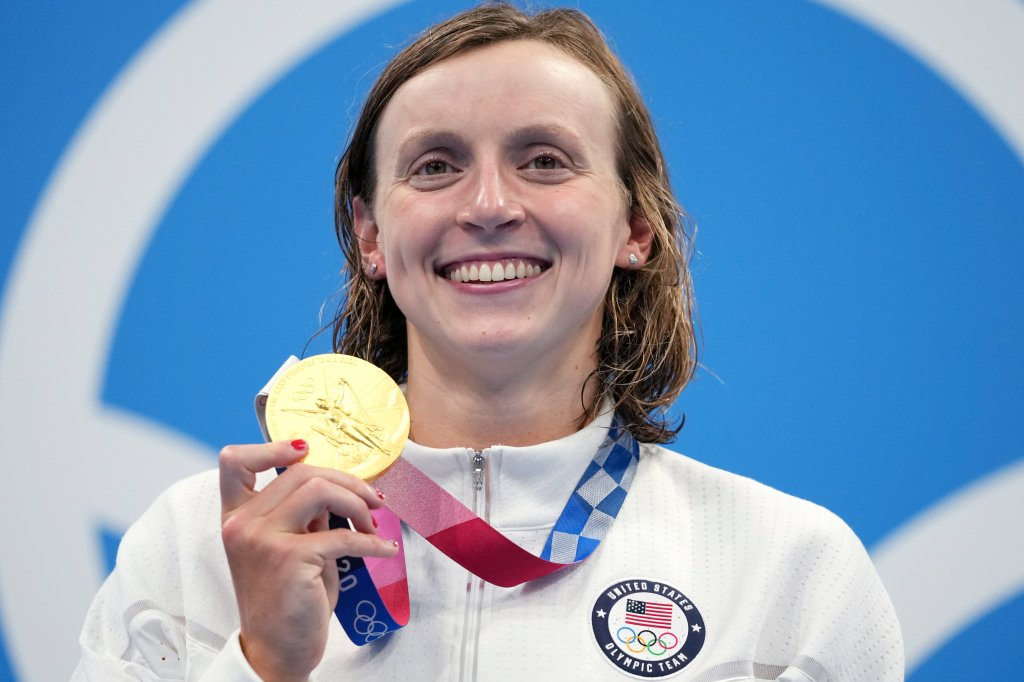 Katie Ledecky of the United States poses with her gold medal after winning the women's 1500-meters freestyle final at the 2020 Summer Olympics, Wednesday, July 28, 2021, in Tokyo, Japan.
