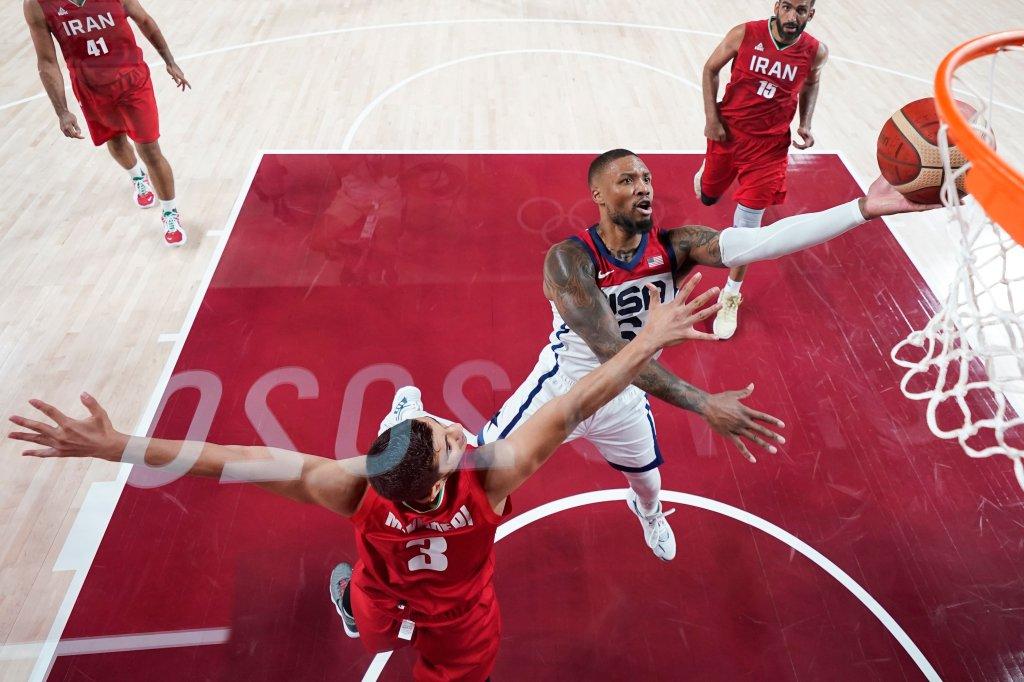 United States' Damian Lillard (6) shoots over Iran's Mohammadsina Vahedi (3) during a men's basketball preliminary round game at the 2020 Summer Olympics, Wednesday, July 28, 2021, in Saitama, Japan.