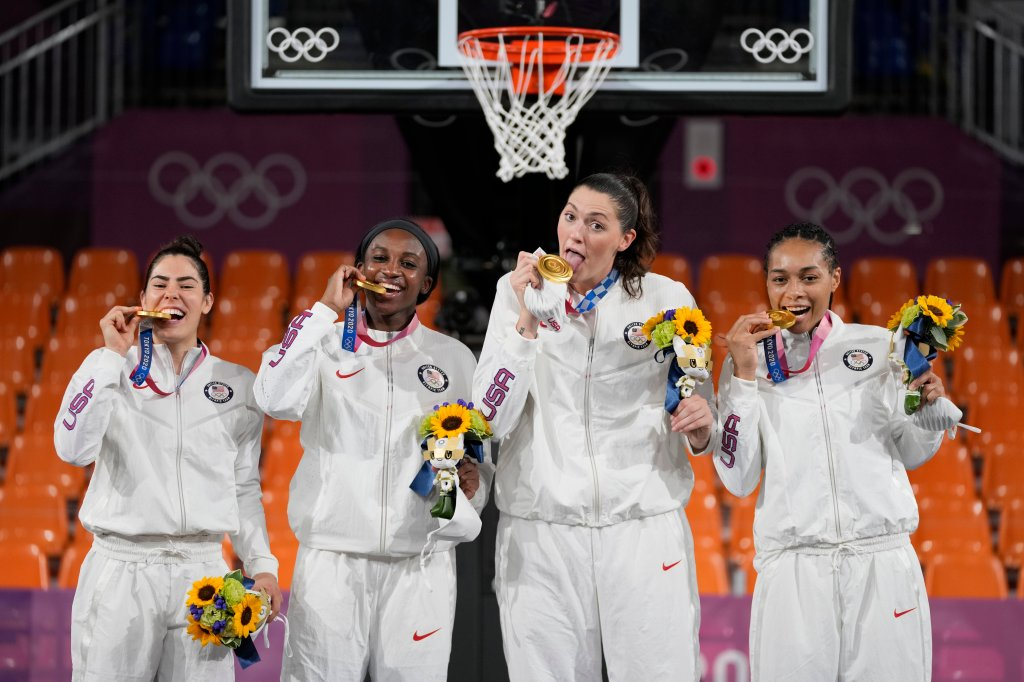From left: Members of Team USA Kelsey Plum, Jacquelyn Young, Stefanie Dolson and Allisha Gray pose with their gold medals during the awards ceremony for women's 3-on-3 basketball at the 2020 Summer Olympics, Wednesday, July 28, 2021, in Tokyo, Japan. They became the first Olympians to win a gold medal in the women's 3x3 basketball category.