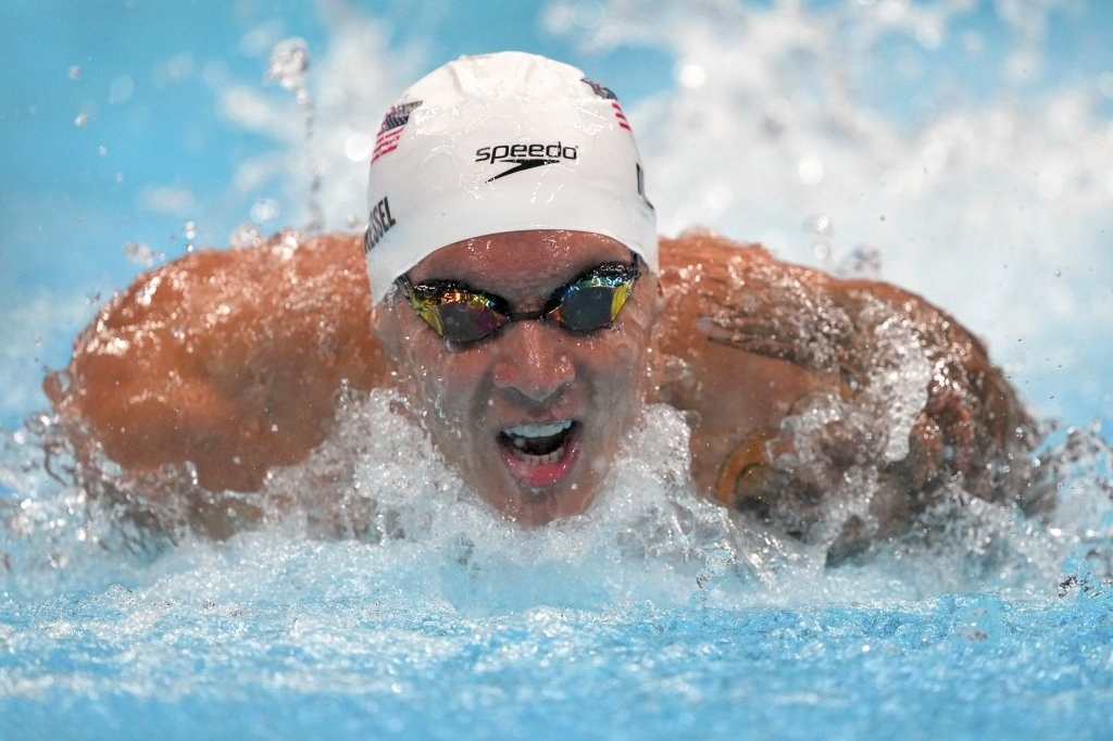 Caeleb Dressel of the United States swims in a heat of the men's 100-meter butterfly at the 2020 Summer Olympics, Thursday, July 29, 2021, in Tokyo, Japan.