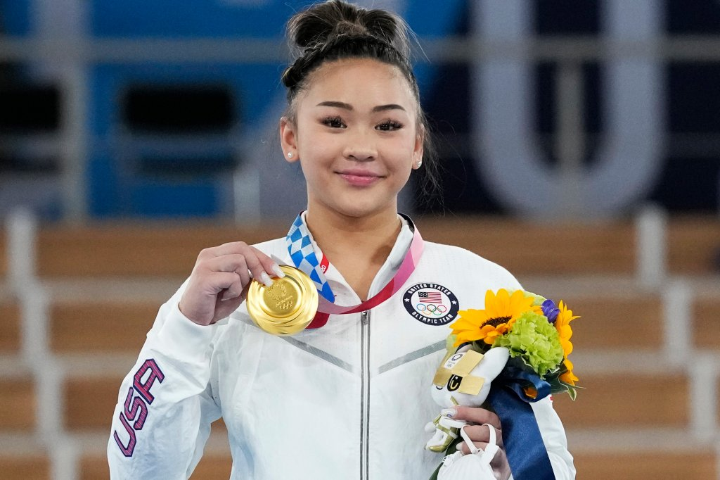 Gold medallist Sunisa Lee of the Unites States displays her medal for the artistic gymnastics women's all-around at the 2020 Summer Olympics, Thursday, July 29, 2021, in Tokyo. Lee took home gold for the United States for the fifth year running in this category.