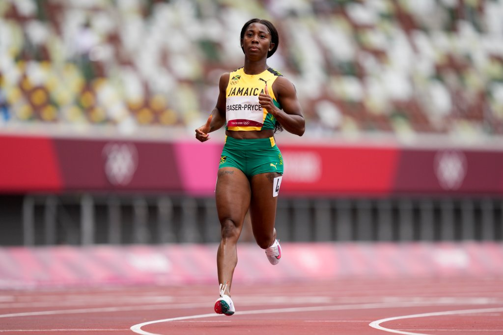 Shelly-Ann Fraser-Pryce of Jamaica wins a heat in the women's 100-meter run at the 2020 Summer Olympics, Friday, July 30, 2021, in Tokyo.
