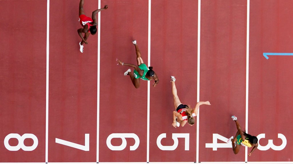 Shelly-Ann Fraser-Pryce of Jamaica, Ajla Del Ponte of Switzerland, Nzubechi Nwokocha of Nigeria and Gina Bass of Gambia compete during the first round of the women's 100-meter the 2020 Summer Olympics, Friday, July 30, 2021, in Tokyo.