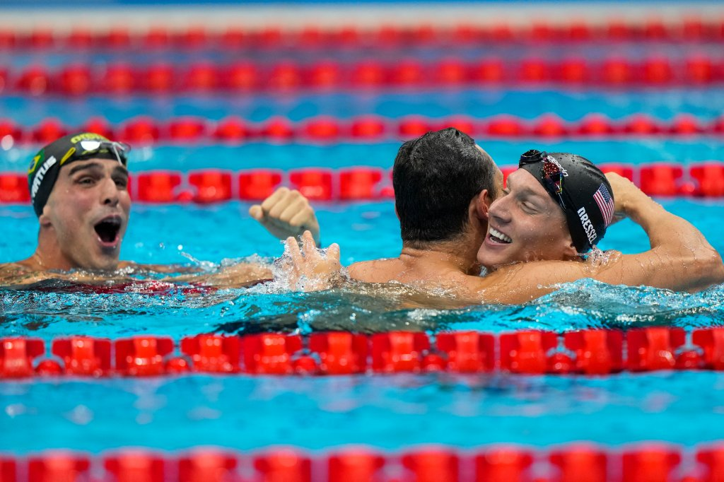 Caeleb Dressel, of United States, celebrates after winning the gold medal in a men's 50-meter freestyle fiat the 2020 Summer Olympics, Sunday, Aug. 1, 2021, in Tokyo, Japan. At left Bruno Fratus, of Brazil, celebrates winning the bronze medal.