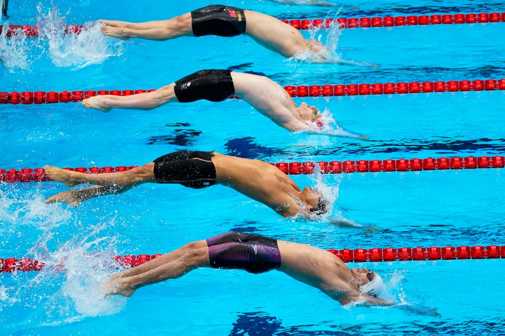 Swimmers start in the men's 4x100-meter medley relay final at the 2020 Summer Olympics, Sunday, Aug. 1, 2021, in Tokyo, Japan.