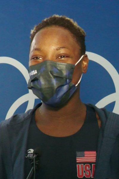 Team USA water polo goalkeeper Ashleigh Johnson smiles under her mask