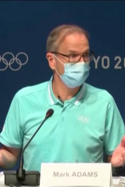 Mark Adams, a spokesperson for the International Olympic Committee, gestures while speaking