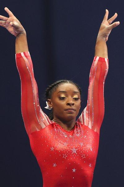 Gymnast Simone Biles performs on the mat