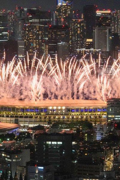 Fireworks illuminate the National Stadium in Tokyo