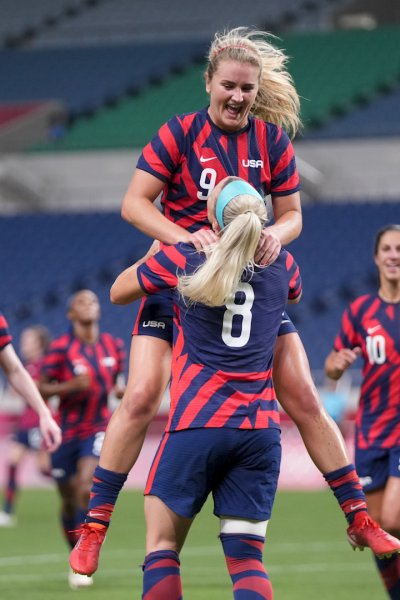 The U.S. women's soccer team celebrates in their game against New Zealand