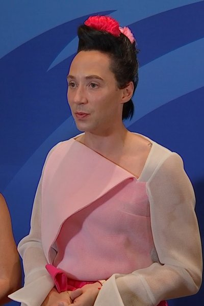 Olympic figure skaters Johnny Weir and Tara Lipinski stand for an interview