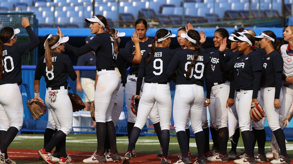 Pitcher Monica Abbott #14 of Team United States and teammates high five after their 2-0 win against Team Mexico during the Softball Opening Round on day one of the Tokyo 2020 Olympic Games at Yokohama Baseball Stadium on July 24, 2021 in Yokohama, Kanagawa, Japan.