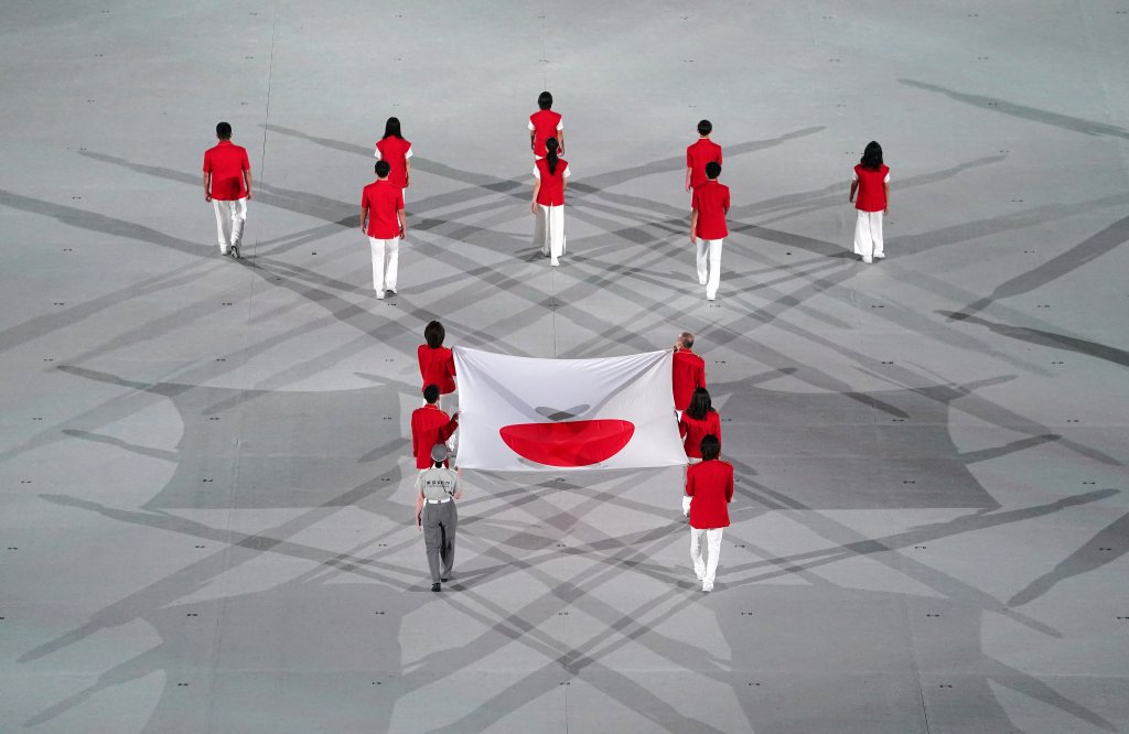 The Japanese National Flag is carried out during the opening ceremony of the Tokyo 2020 Olympic Games at the Olympic Stadium in Tokyo, July 23, 2021.