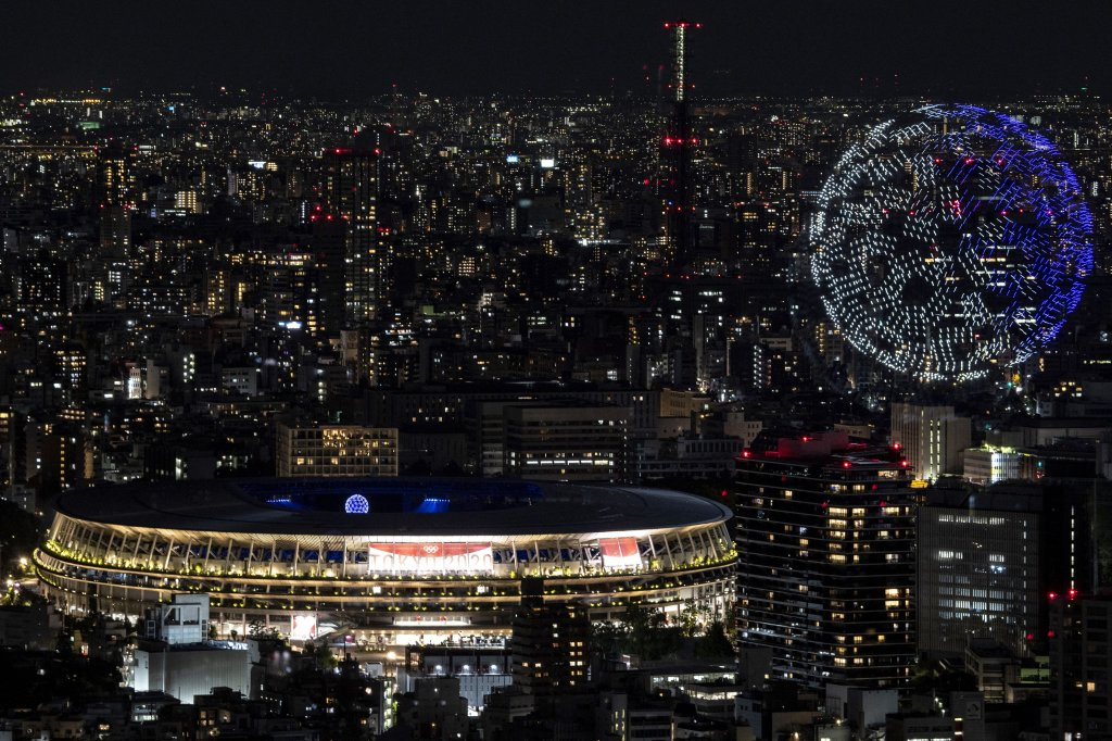 Drones fly to form an image of the Earth in the sky over the Olympic Stadium during the opening ceremony of the Tokyo 2020 Olympic Games, in Tokyo, on July 23, 2021.