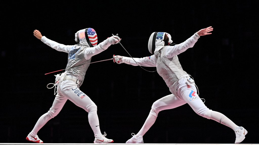 USA's Lee Kiefer, left, compete against Russia's Inna Deriglazova in the women's foil individual gold medal bout during the Tokyo 2020 Olympic Games at the Makuhari Messe Hall in Chiba City, Chiba Prefecture, Japan, on July 25, 2021.