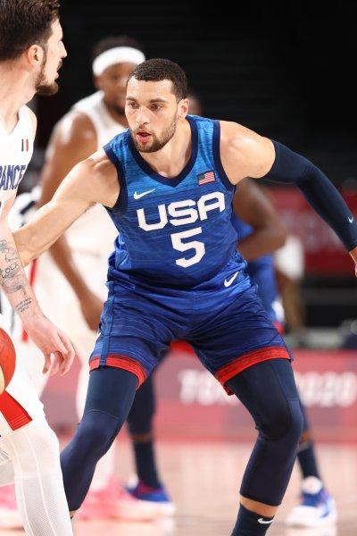 USA basketball player Zach LaVine defends France