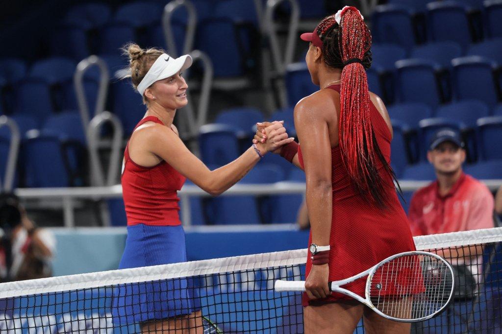 Czech Republic's Marketa Vondrousova (L) shakes hands with Japan's Naomi Osaka after winning their Tokyo 2020 Olympic Games women's singles third round tennis match at the Ariake Tennis Park in Tokyo on July 27, 2021.