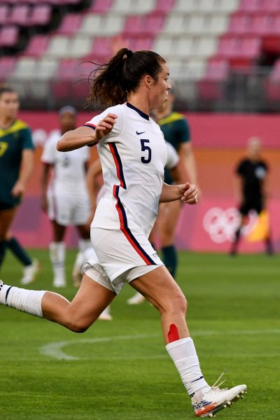 USA's defender Kelley O'Hara chases the ball during the Tokyo 2020 Olympic Games women's group G first round football match between USA and Australia