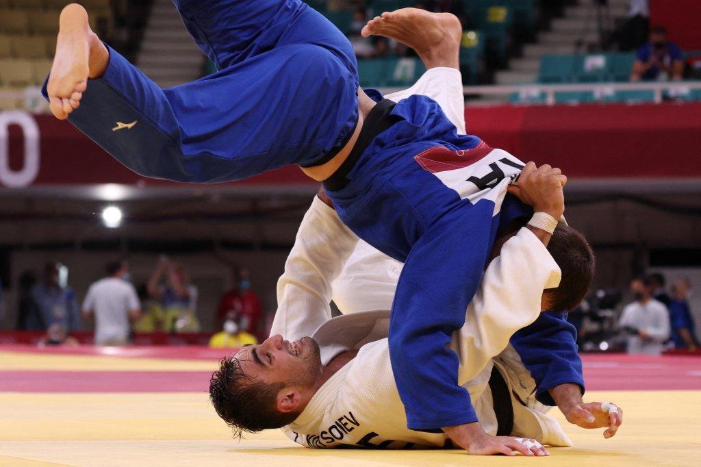 Azerbaijan's Zelym Kotsoiev and France's Alexandre Iddir compete