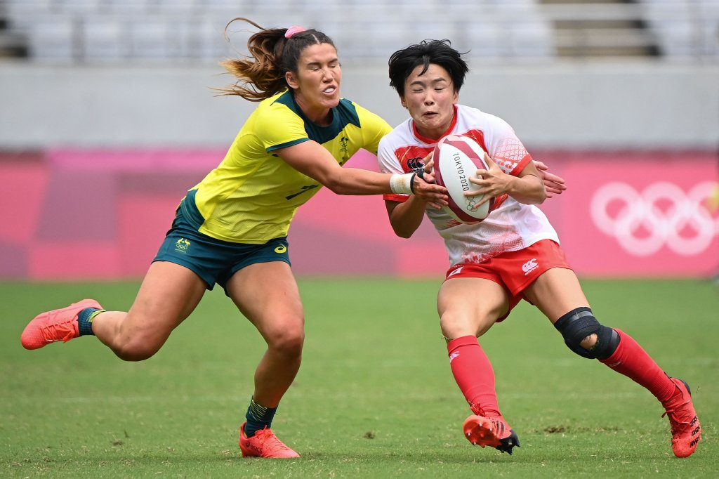 Australia's Charlotte Caslick tackles Japan's Wakaba Hara