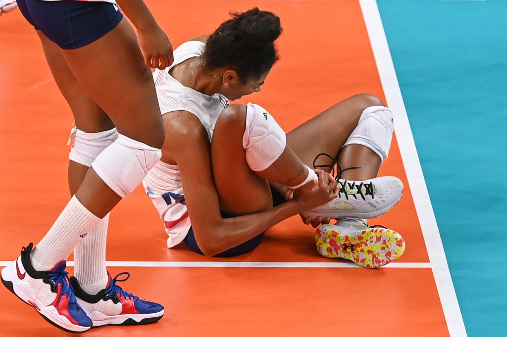 USA's Jordan Thompson reacts after getting injured in the women's preliminary round pool B volleyball match between USA and Russia during the Tokyo 2020 Olympic Games at Ariake Arena in Tokyo on July 31, 2021.