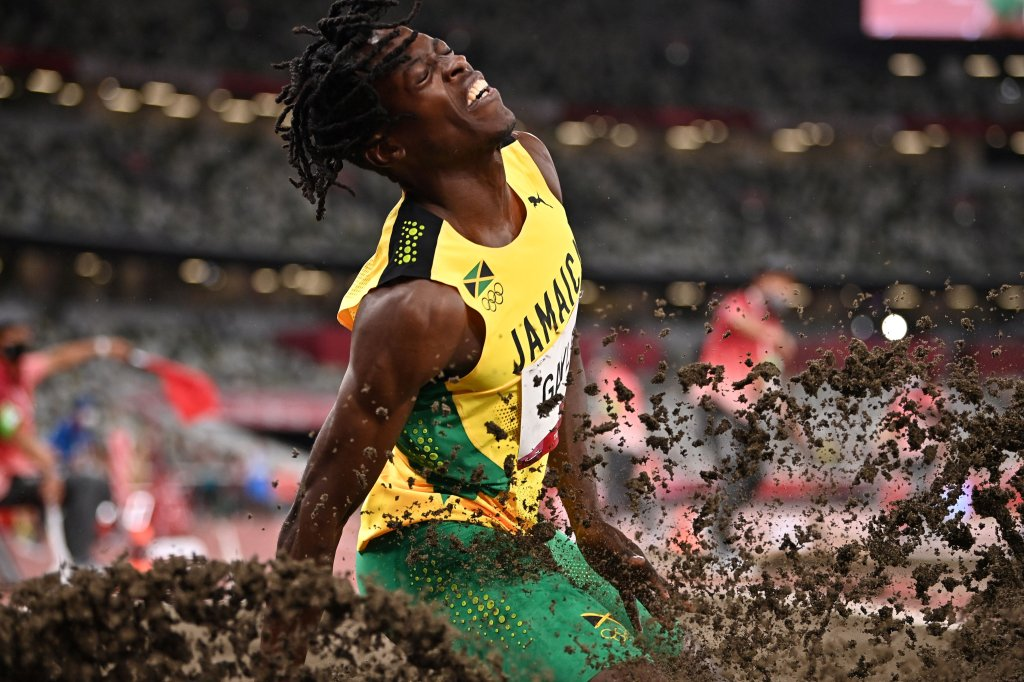 Jamaica's Tajay Gayle lands during the men's long jump qualification during the Tokyo 2020 Olympic Games at the Olympic Stadium in Tokyo on July 31, 2021.