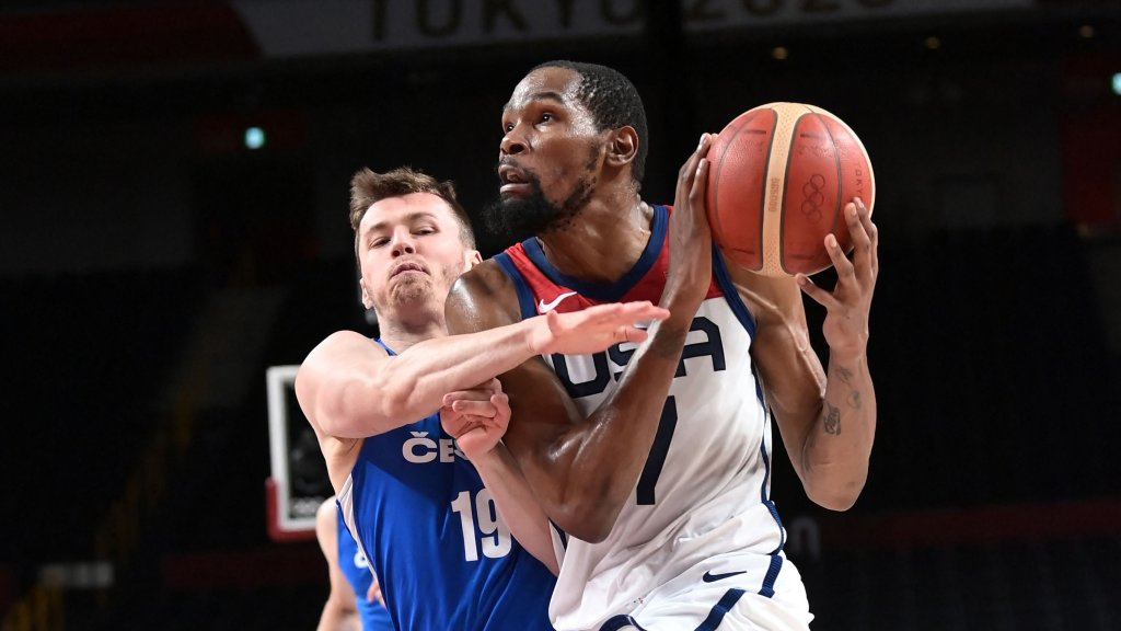 Team USA's Kevin Durant goes to the basket past Czech Republic's Ondrej Sehnal in the men's preliminary round group A basketball match between USA and Czech Republic during the Tokyo 2020 Olympic Games at the Saitama Super Arena in Saitama on July 31, 2021.