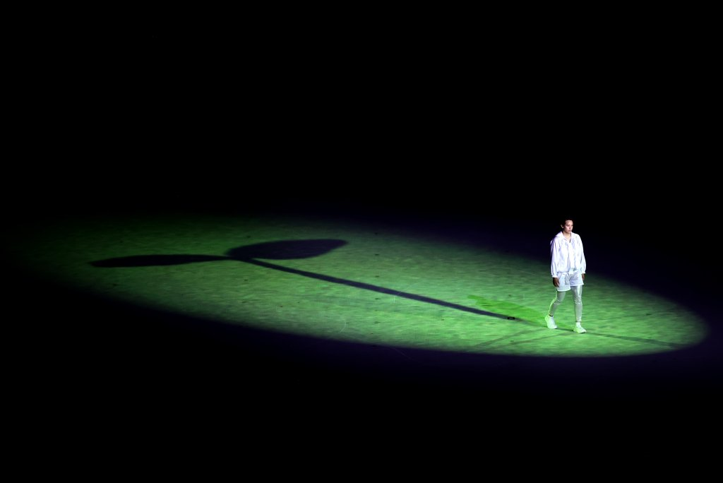 A performer symbolizing the individual athlete training separately yet still united, during the Opening Ceremony of the Tokyo 2020 Olympic Games at Olympic Stadium on July 23, 2021 in Tokyo, Japan.