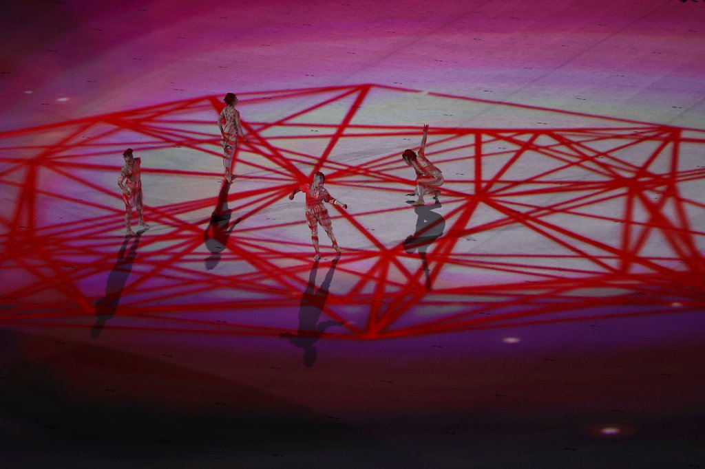 Performers symbolizing connections and unity are seen during the light show in the Opening Ceremony of the Tokyo 2020 Olympic Games at Olympic Stadium on July 23, 2021 in Tokyo, Japan.