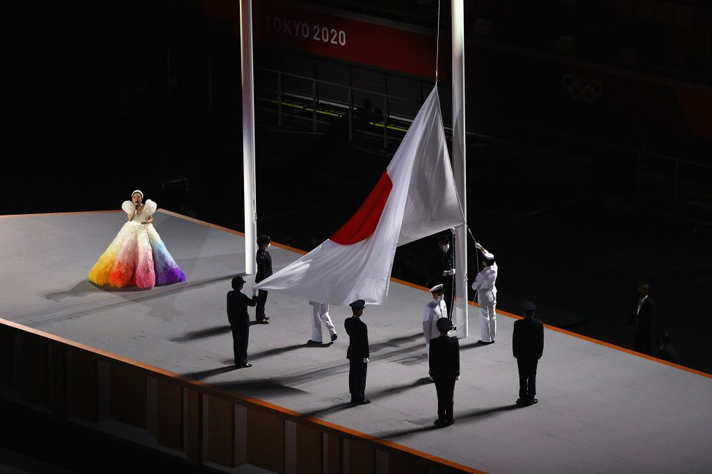 Misia sings the Japanese national anthem as the Japanese flag is hoisted during the Opening Ceremony of the Tokyo 2020 Olympic Games at Olympic Stadium on July 23, 2021 in Tokyo, Japan.