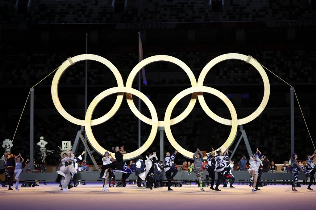Performers dance as they assemble the Olympic Rings during the Opening Ceremony of the Tokyo 2020 Olympic Games at Olympic Stadium on July 23, 2021 in Tokyo, Japan.