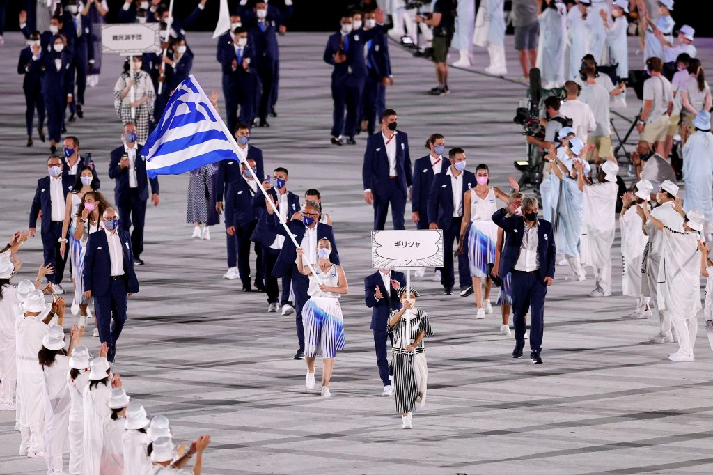 Flag bearers Anna Korakaki and Eleftherios Petrounias of Team Greece lead their team in during the Opening Ceremony of the Tokyo 2020 Olympic Games at Olympic Stadium on July 23, 2021 in Tokyo, Japan. Greece leads the delegation first as a nod to the Olympic's Greek origins.