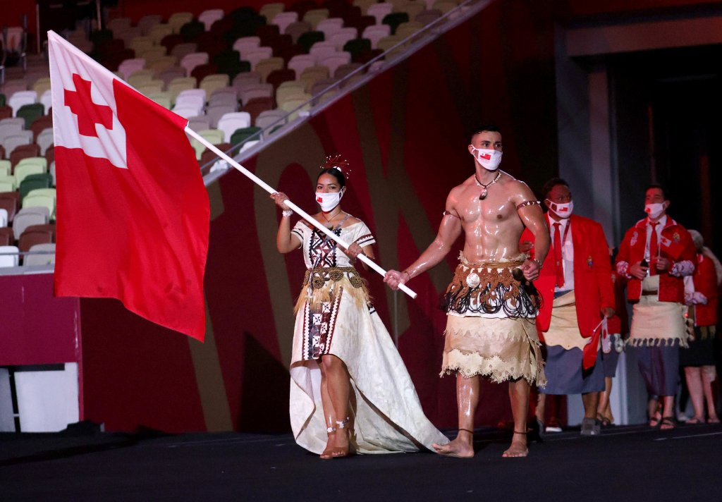 Flag bearers Malia Paseka and Pita Taufatofua of Team Tonga lead their team out during the Opening Ceremony of the Tokyo 2020 Olympic Games at Olympic Stadium on July 23, 2021 in Tokyo, Japan.