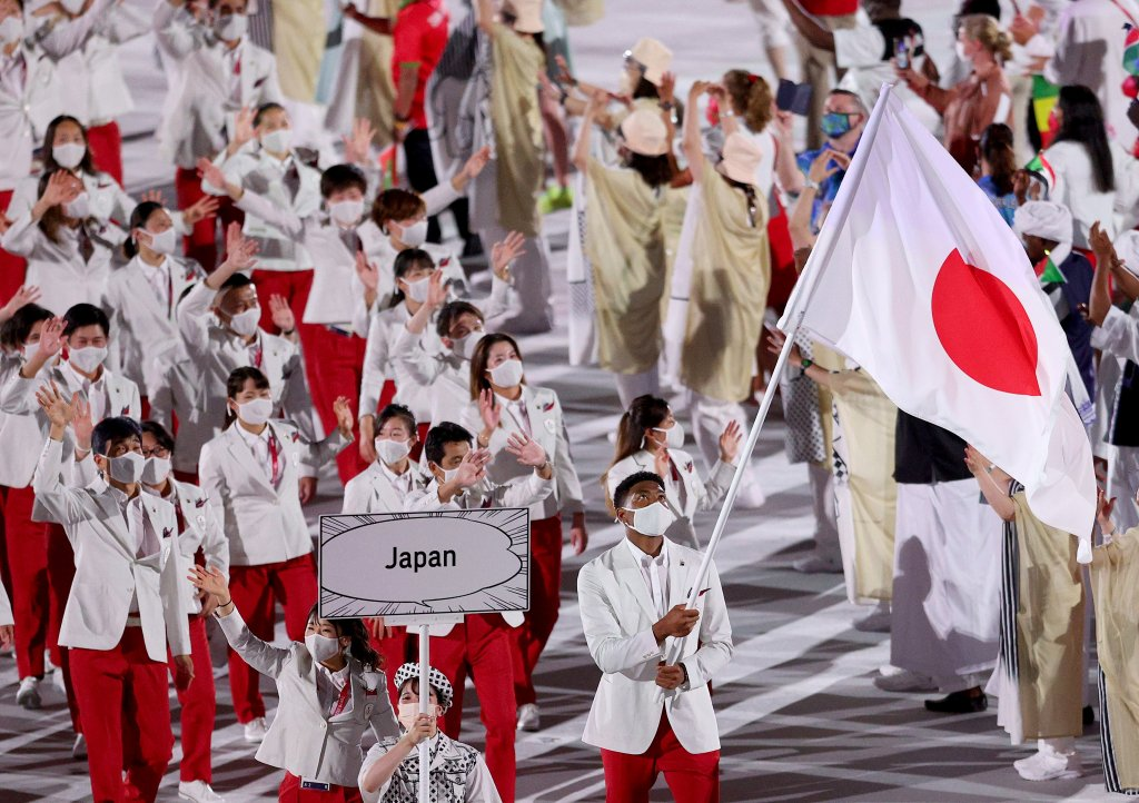 Flag bearers Yui Susaki and Rui Hachimura of Team Japan lead their team in during the Opening Ceremony of the Tokyo 2020 Olympic Games at Olympic Stadium on July 23, 2021 in Tokyo, Japan.