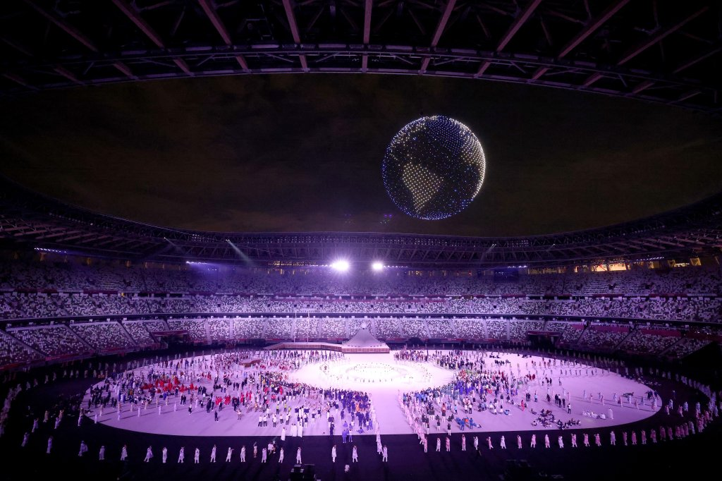 A drone display flies over the top of the stadium during the Opening Ceremony of the Tokyo 2020 Olympic Games at Olympic Stadium on July 23, 2021 in Tokyo, Japan.