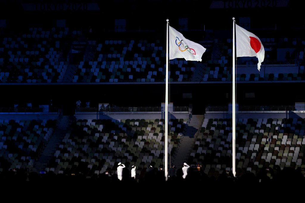 The Olympic flag is raised alongside the Japanese flag during the Opening Ceremony of the Tokyo 2020 Olympic Games at Olympic Stadium on July 23, 2021 in Tokyo, Japan.