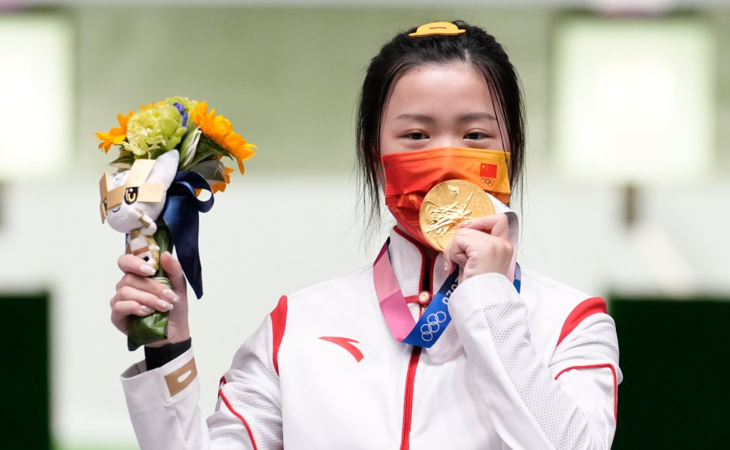 Gold medalist Yang Qian of China celebrates on the podium after the 10m Air Rifle Women's Final on the first day of the Tokyo 2020 Olympic Games at the Asaka Shooting Range on July 24, 2021, Saitama, Japan. Yang was the first to win a gold medal in Tokyo.