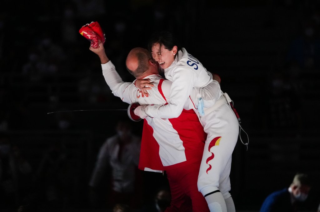 Sun Yiwen of China celebrates with her coach Hugues Obry after winning the Women's Epee Individual gold medal bout of the fencing on day one of the Tokyo 2020 Olympic Games at Makuhari Messe Hall on July 24, 2021, in Chiba, Japan.