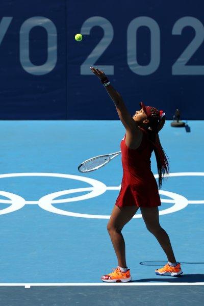 Naomi Osaka serves
