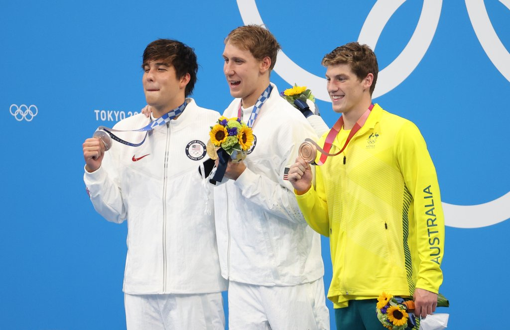 Gold medalist Chase Kalisz of USA, silver medalist Jay Litherland of USA and bronze medalist Brendon Smith of Australia hold up their medals during the medals ceremony of the 400m individual medley final on day two of the Tokyo 2020 Olympic Games at Tokyo Aquatics Centre on July 25, 2021 in Tokyo, Japan.