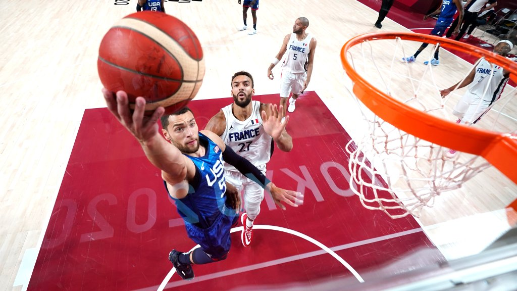 Zach LaVine #5 of Team United States drives past Rudy Gobert #27 of Team France for a layup during the second half of the Men's Preliminary Round Group B game on day two of the Tokyo 2020 Olympic Games at Saitama Super Arena on July 25, 2021 in Saitama, Japan.